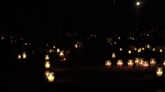 Graveyard decorated with candles for All Saints Day at night. 4K Stock Footage