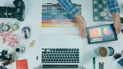 Creative professional graphic designer desk. Above view Stock Footage