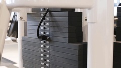 The athlete makes exercise on the trainer. Close-up of a stack of cargo Stock Footage
