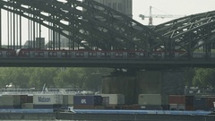 Cologne Railway Bridge over Shipping on River Rhine Stock Footage