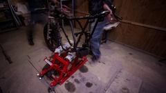 TIMELAPSE - Friends assembling a custom cafe racer motorcycle in a garage Stock Footage