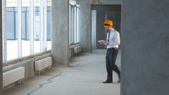 Construction engineer, businessman, realtor inside a new building inspecting Stock Footage