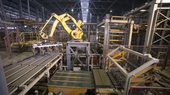 Industrial robot. Robotic arm assembling products on a modern plant Stock Footage