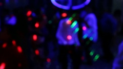 Many defocused people cheerfully dancing at dance floor of night club Arkistovideo