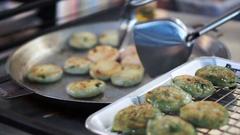 Fresh fried chives dim sum or fried leek dumpling. Chinese style breakfast food Stock Footage
