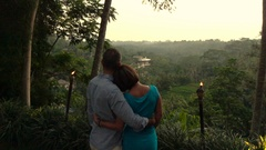 Couple in love hugging and admire exotic garden, super slow motion 240fps Stock Footage