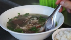 Jelly pork blood soup with organs and herb vegetable, Thai style breakfast Stock Footage