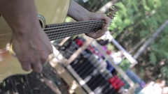 Guitar playing closeup outdoor festival Stock Footage