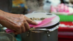 Pak Mor at Thai local snack, steamed rice flour sheet with stuffing Stock Footage
