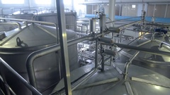 Production tanks, storages at a brewery. Pipline at a brewery factory Stock Footage