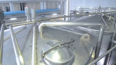 Storage Tanks in Brewery. Brewing factory indoors. Steadycam shot Stock Footage