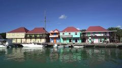 Colorful Caribbean waterfront houses, buildings - Port of Antigua Stock Footage