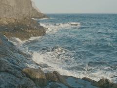 Ocean, blue water waves crashing on volcanic rocks. Stock Footage