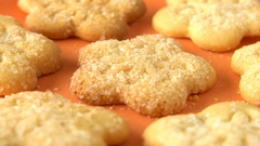 Delicious yummy freshly baked homemade cookies rotating on a orange bamboo plate Stock Footage