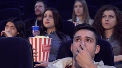 People watch serious film at the movie theater Stock Footage