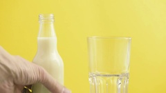 Pouring soy milk in a glass from bottle. Film clip of vegan dairy drink. Stock Footage