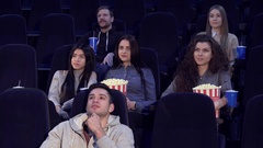Young people watch film at the movie theater Stock Footage