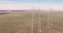 Aerial of power transmission lines Stock Footage