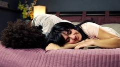 Man hugging girlfriend in bed Stock Footage