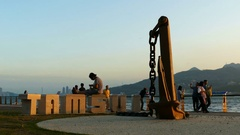 Large letters Tamsui at the Tamsui river at sunset Stock Footage