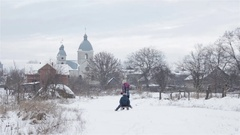 Fun sledding in the village Stock Footage