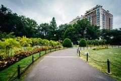 Walkway and gardens at the Public Garden in Boston, Massachusetts. Stock Photos
