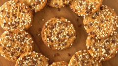 Delicious yummy freshly baked homemade cookies rotating on a wooden board Stock Footage