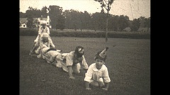 Vintage 16mm film, 1930, America in the 1930s, children playing leapfrog Stock Footage
