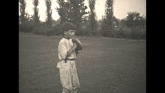 Vintage 16mm film, 1930, children playing baseball, pitcher Stock Footage