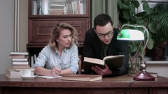 Young professor in glasses helping female student with her report Stock Footage