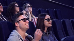 People laugh at the movie theater Stock Footage
