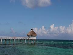 Mexico beautiful Caribbean Ocean pier and cabana DCI 4K Stock Footage