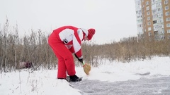 Woman sweeps the snow from carpet Stock Footage