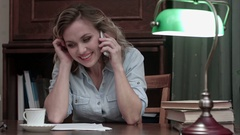 Cheerful and laughing woman talking on the phone resting after work Stock Footage