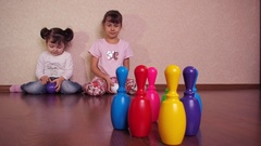 Hildren playing with pins Stock Footage