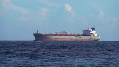 Anchored tanker or cargo ship waiting at sea Stock Footage