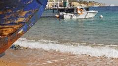 Beach in Egypt. Resort Red Sea Coast. Coast guard boat near the seaport Stock Footage