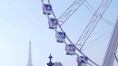 PARIS, FRANCE: Observation wheel in Paris and piece of Eiffel Tower  in smog. Stock Footage