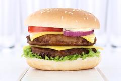 Double cheeseburger hamburger burger fresh tomatoes lettuce cheese Stock Photos