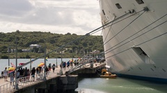 Time lapse of cruise ship passengers embark, boarding - Antigua Stock Footage