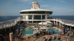 Time lapse of Cruise ship pool deck, swimming pool - Adventure of the Seas Stock Footage