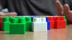 Colorful kid constructor bricks Stock Footage