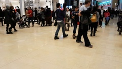 Crowds of people pushing and shoving for bargains in shopping mall on boxing day Stock Footage