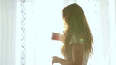 Woman in the morning drinking tea or coffee. Stock Footage