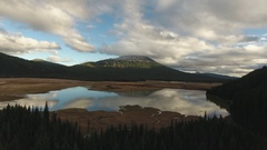 Glass lake at the base of Mt Bachelor Stock Footage