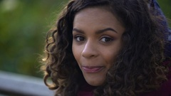 Beautiful biracial woman posing for camera and smiling sincerely, face close-up Stock Footage