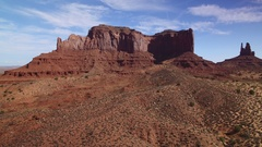 Monument Valley Aerial Shot of Rock Formation in Utah Desert - Right USA Stock Footage
