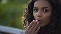 Pretty curly-haired girl sending air kisses for camera, happiness, emotions Stock Footage