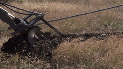 Mechanised Trench Digger at work Stock Footage