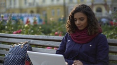 Female student studying on laptop outdoors, writing essay, blogging for website Stock Footage